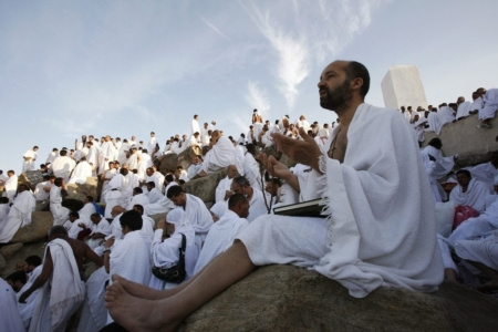 A Muslim pilgrim prays on Mount Mercy on the plains of Arafat outside the holy city of Mecca December 7, 2008. More than two million Muslims began the haj pilgrimage on Saturday, heading to a tent camp outside Mecca to follow the route Prophet Mohammad took 14 centuries ago. REUTERS/Ahmed Jadallah (SAUDI ARABIA)