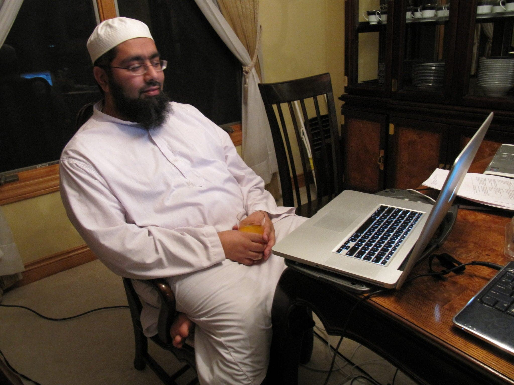 Shaykh Faraz checking his e-mail after a long day of meetings on Saturday.