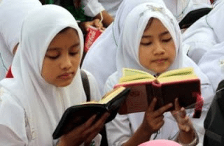 Girls Reading Quran.png