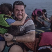 Laith Majid cries tears of joy and relief that he and his children have made it to Europe. Photograph: Daniet Etter/New York Times/Redux /eyevine