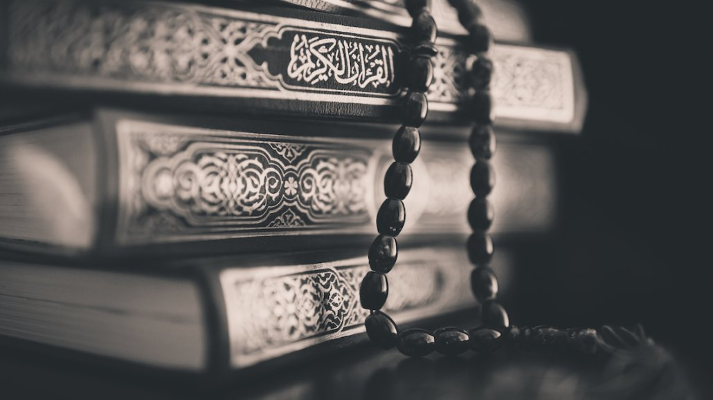 Rulings Related to the Quran and a Woman in the State of