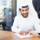 Arab,Man,Giving,Documents,To,Sign,To,A,Woman,In
